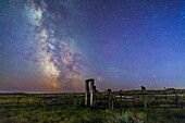 Mars (bottom) and Saturn in conjunction at right, and the Milky Way at left, in deep blue twilight before the sky got filly dark, over the old corral of the 76 Ranch, in Grasslands National Park, Saskatchewan, August 27/28, 2014. Antares and Scorpius are