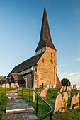 Sunset at St Michael ad Vincula church in Wisborough Green village, West Sussex, England.