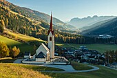 Autumn morning at iconic alpine church in Winnebach, South Tyrol, Italy.