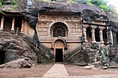 Cave 18 : Façade of chaitya of Pandavleni Cave. Contains beautiful carvings and stupa. Nasik, Maharashtra, India. Inscription on two pillars tells that Chaitya was built by Bhattapalika, wife of the Royal Officer Aghetyana.