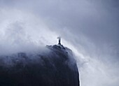 Brazil, City of Rio de Janeiro, Zona Sul, Corcovado and Christ Statue viewed from the Botanical Garden on moody, cloudy day.