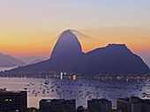 Brazil, City of Rio de Janeiro, View over Botafogo Neighbourhood towards the Sugarloaf Mountain at sunrise.