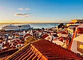 Portugal, Lisbon, Miradouro das Portas do Sol, View over Alfama Neighbourhood towards the Tagus River at sunrise.
