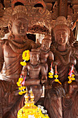 'Sanctuary of Truth wooden building with hundreds of carved Buddhist figures; Pattaya, Thailand'