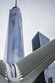 'Modern structure with white prongs like wings, skyscraper and One World Trade Center; New York City, New York, United States of America'