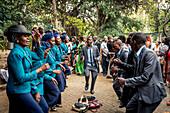 'Wedding guests celebrating in Tunduru Botanical Gardens, designed in 1885 by British gardener Thomas Honney; Maputo, Mozambique'