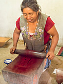 Zapotec woman grinding insects to make valuable cochineal dye, Teotitlan del Valle, Oaxaca, Mexico, North America