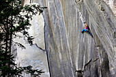 A climber ascending a difficult crack climb, Cadarese Valley, northern Italy, Europe