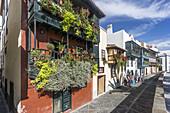 Row of houses along Avenida Maritima, wooden balconies with flowers, Santa Cruz, La Palma, Canary Islands, Spain