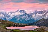 Strino lakes, Val di Sole, Trentino Alto Adige, Italy, The imposing Presanella's north face at sunset seen from Strino lakes, near Tonale pass
