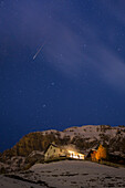 Europe, Italy, Sondrio, Alpin chalet during a winter starring night , Livigno , Valtellina , Italian Alps
