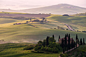 Europe, Italy, Podere Belvedere sunrise in Tuscany, province of Siena, Orcia Valley