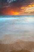 Catania, Sicily, Italy, Ethereal sea with clouds painted by the sunset's light