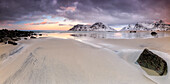 Panoramic view of the sandy beach of Skagsanden under a cloudy pink sky, Lofoten Islands, Northern Norway, Europe