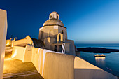 Lights of the church and of a cruise ship as a contrast with blue of Aegean Sea Firostefani Santorini Cyclades Greece Europe