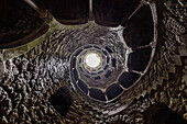 Spiral stairs and mystical atmosphere inside the towers of Initiation Well at Quinta da Regaleira Sintra Portugal Europe