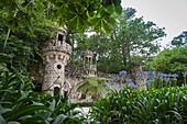 Mystical constructions of Romanesque Gothic and Renaissance style inside the park Quinta da Regaleira Sintra Portugal Europe