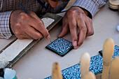 Khiva, Uzbekistan, Central Asia, An artist paints a majolica in Khiva