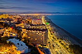 Panoramic landscape at dusk beaches, hotels and El Bajondillo, Torremolinos. Malaga province Costa del Sol. Andalusia Southern Spain, Europe.