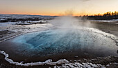 The geothermal area Haukadalur part of the touristic route Golden Circle during winter. Geysir Strokkur in the background. europe, northern europe, iceland, February.