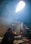 Wakhi nomad family eating breakfast inside their yurt, Big pamir, Wakhan, Afghanistan.