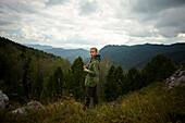 Portrait of Caucasian girl standing on mountain range