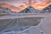 Wind blows on the cold sea of Uttakleiv at dawn, Lofoten Islands Norway Europe