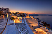 The dusk lights illuminate the typical greek village of Oia Santorini Cyclades South Aegean Greece Europe