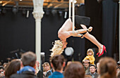 Europe, France, Paris (75), 3rd arrondissement, Le Marais, the 'Carreau du Temple'. April 25th, 2014. Opening day. Funny Acrobatic show. It is a former clothes market that was redeployed in a cultural and sport center in 2014