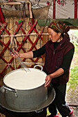 Kyrgyzstan, Issyk Kul Province (Ysyk-Kol), Juuku valley, thanks to a Swiss cooperation, Nurgul Toktosounova has learned how to make cheese