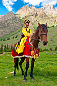 Kyrgyzstan, Issyk Kul Province (Ysyk-Kol), Juuku valley, Goulzana Talantbekoze wears the traditional Kiz Kumai clothes, a horse game where the man tries to catch a girl on horseback and kiss her