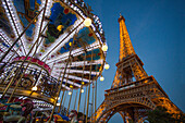 France, Paris, merry-go-round in front of the Eiffel Tower at dusk