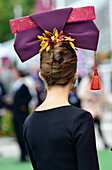 France, Paris 16th district, Longchamp Racecourse, Qatar Prix de l'Arc de Triomphe on October 4th and 5th 2014, Elegant and  fashionable young lady seen from behind wearing a hat