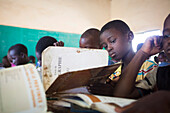 Burkina Faso, the village of Ponsom Tenga located 20 kilometers from Ouagadougou, 10-year-old child in 3rd grade in front of his geography book