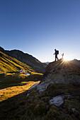 A man hiking, New Regensburg hut, Stubaier Höhenweg, Stubaital, Tyrol, Austria, Europe