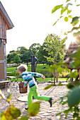 Holiday in the countryside, farm, farm house Bauernkate, garden, boy at the fountain, childhood, MR, Biosphere Reserve Schaalsee, Mecklenburg lake district, Klein Thurow, Mecklenburg-West Pomerania, Germany, Europe