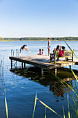 Swimming, diving into water, family, playing in the water, holiday, summer, swimming, sport, lake Neuklostersee, Mecklenburg lakes, Mecklenburg lake district, Neukloster, Mecklenburg-West Pomerania, Germany, Europe
