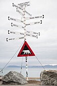 Attention polar bears -  warning sign next to the entrance of Longyearbyen airport, Spitzbergen, Svalbard
