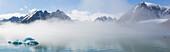 Small icebergs in the mist at Liefdefjorden, Spitzbergen, Svalbard