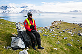 Guide Felicity Aston (she is the 3rd person to cross the south pole alone on skis) on polarbear whatch to guard tourists on island of Gnalodden Spitzbergen, Svalbard  GUIDE UND ABENTEURERIN