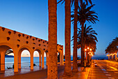 arcades and palm trees at night, Balcon de Europa, viewpoint to the Mediterranean Sea, Nerja, Costa del Sol, Malaga province, Andalucia, Spain, Europe