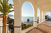 Arcades and palm trees, Balcon de Europa, viewpoint to the mediterranean sea, Nerja, Costa del Sol, Malaga province, Andalucia, Spain, Europe