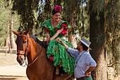 Horse rider, woman, El Rocio pilgrimage, Pentecost festivity, Huelva province, Sevilla province, Andalucia, Spain, Europe