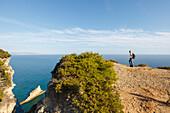 hiking, man observing the view, Parque Natural de la Brena, nature park, near Los Canos de Meca, near Vejer de la Frontera, Costa de la Luz, Atlantic Ocean, Cadiz province, Andalucia, Spain, Europe