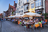 Restaurants at the Stintmarkt by the old harbour in the Hanseatic town Lüneburg, Lower Saxony, Northern Germany, Germany, Europe