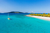 A Sailboat Moored Off An Uninhabited Islet Of The British Virgin Islands In The Caribbean