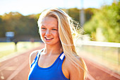 Portrait Of An Young Smiling Female Athlete
