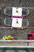 Elevated View Of A Restaurant Tables In The Colorful Alleyways And Cobblestone Streets Of The Bairro Alto Neighborhood In Lisbon, Portugal