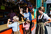 Family at the Shooting Gallery at Octoberfest, Munich, Bavaria, Germany