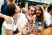 Young Couple in the Beer Tent, Octoberfest, Munich, Bavaria, Germany